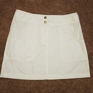 White mini skirt.